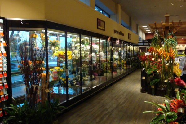 Interior flower shop with 17-door floral display case