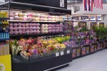 Side view of open front floral case with conversion flip-up shelves - Borgen Systems