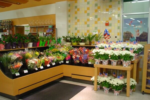 Custom laminate low-profile floral display case with pull-out shelf