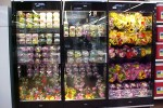 Lei and flower merchandise in 2 door combination floral display case